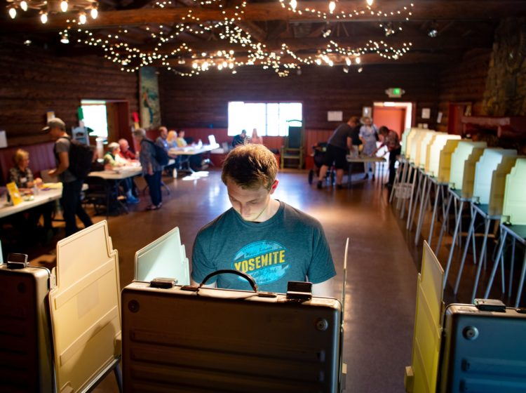 Voters fill out their ballots for the presidential primary in a log cabin run by the American Legion in San Anselmo, Calif., on Super Tuesday, March 3, 2020. While no significant foreign interference was detected, election and law enforcement officials are closely monitoring this year's primaries. (John Edelson/AFP via Getty Images)