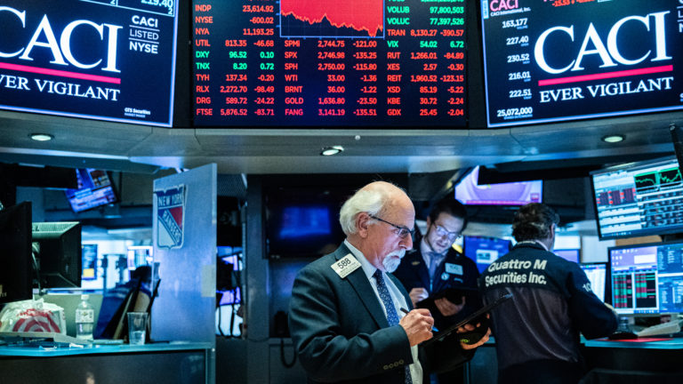 After weeks of turmoil over the economic toll of the coronavirus, U.S. stock indexes entered a bear market, signaling an end to their 11-year winning streak. (Jeenah Moon/Getty Images)