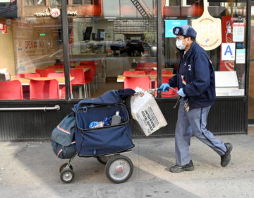 The Postal Service says gloves and surgical masks are made available to all employees who request them, but many postal workers say they don't have what they need. (Jamie McCarthy/Getty Images)