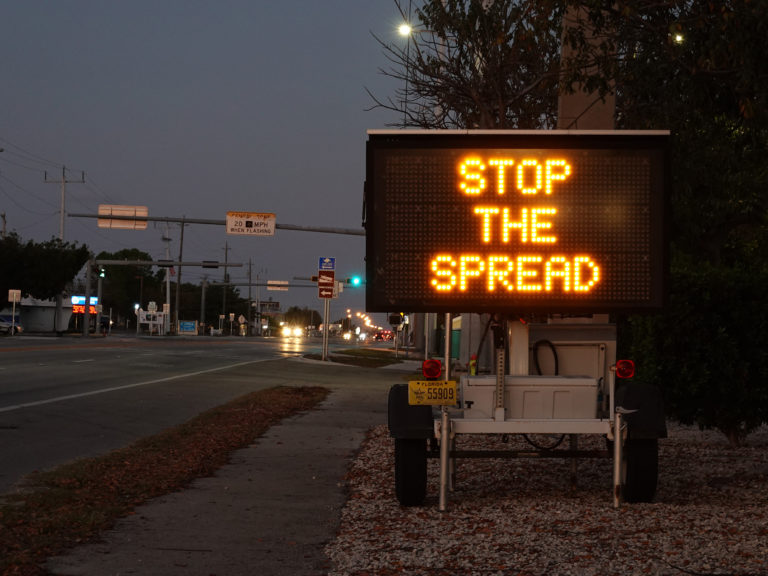 A sign warning motorists about the coronavirus in Key West, Fla. The U.S. Senate passed a $2 trillion relief measure Wednesday night intended to help hospitals, workers and businesses hit hard by the rapidly-spreading virus. (Joe Raedle/Getty Images)