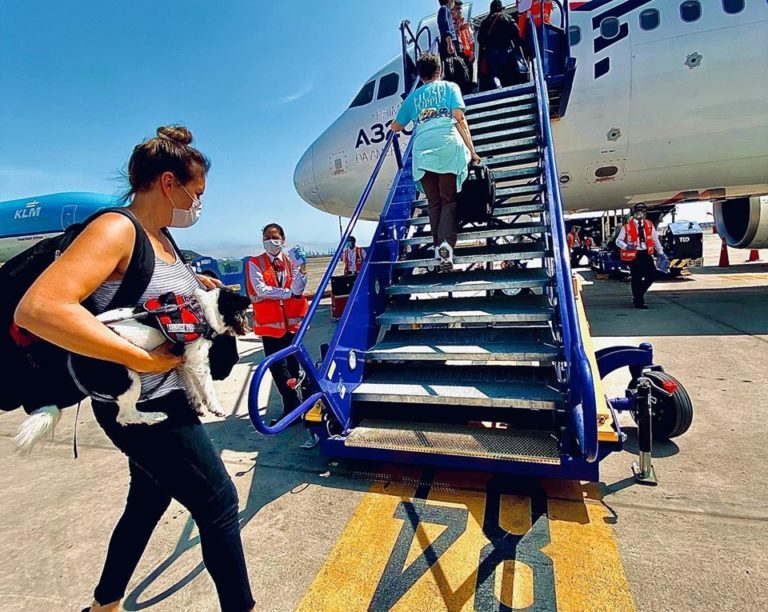 Sara Schuenemann boards last U.S.-bound charter flight out of Peru after being stranded in Lima for 12 days. (Photo courtesy of Richard Levering)