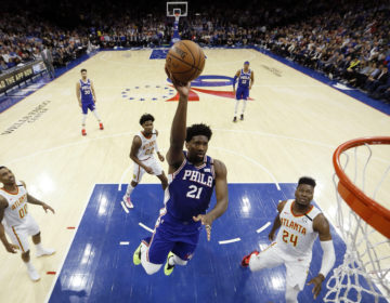 Philadelphia 76ers' Joel Embiid (21) goes up to shoot during the first half of an NBA basketball game against the Atlanta Hawks, Monday, Feb. 24, 2020, in Philadelphia. (AP Photo/Matt Slocum)