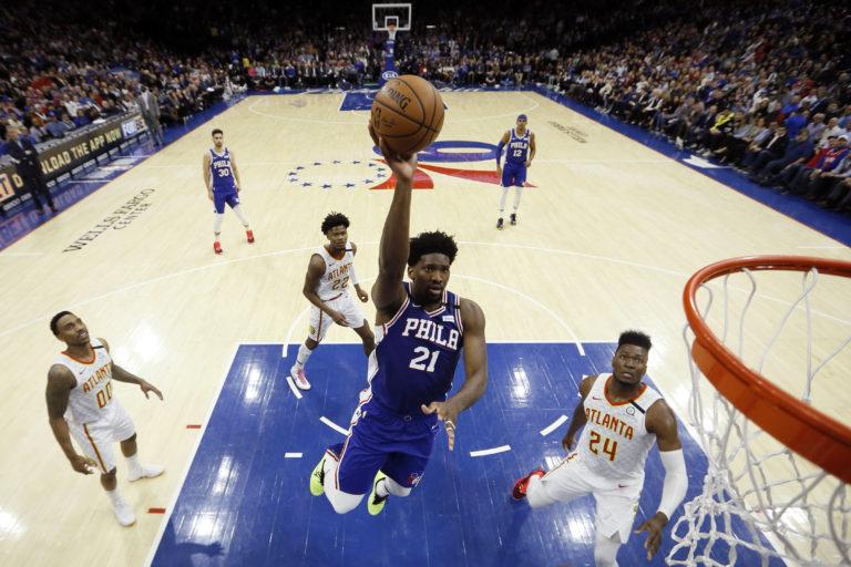 Philadelphia 76ers' Joel Embiid (21) goes up to shoot during the first half of an NBA basketball game against the Atlanta Hawks, Monday, Feb. 24, 2020, in Philadelphia. (AP Photo/Matt Slocum)