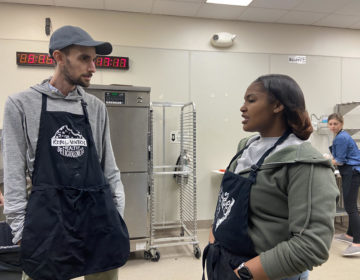 Rebel Ventures co-executive director Jarrett Stein talks with Kennysha Stanley. He and other mentors nominated her for the Breakfast Hero Award. (The Notebook)