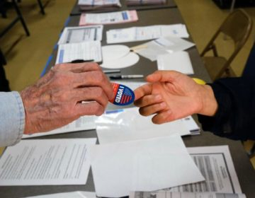 A voter receives his I-Voted sticker, at an early voting polling station at the Ranchito Avenue Elementary School in the Panorama City section of Los Angeles on Monday, March 2. (Richard Vogel/AP Photo)