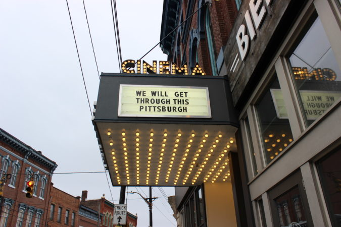 The marquee of Row House Cinema in Pittsburgh's Lawrenceville neighborhood was changed to encourage unity while people self-isolate due to the coronavirus spread. (Katie Blackley/WESA)
