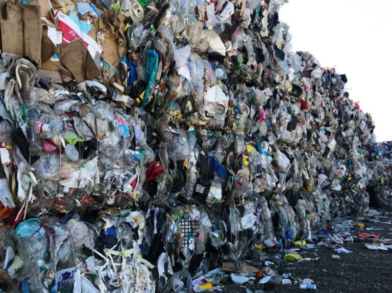 A wall of plastic trash at Garten Services in Salem, Ore., is headed to the landfill. The vast majority of plastic can't be or won't be recycled. (Laura Sullivan / NPR)