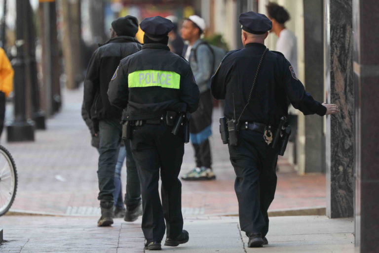 Police officers patrol Market Street in Wilmington, Del., on Thursday, March 26, 2020. (Saquan Stimpson for WHYY)