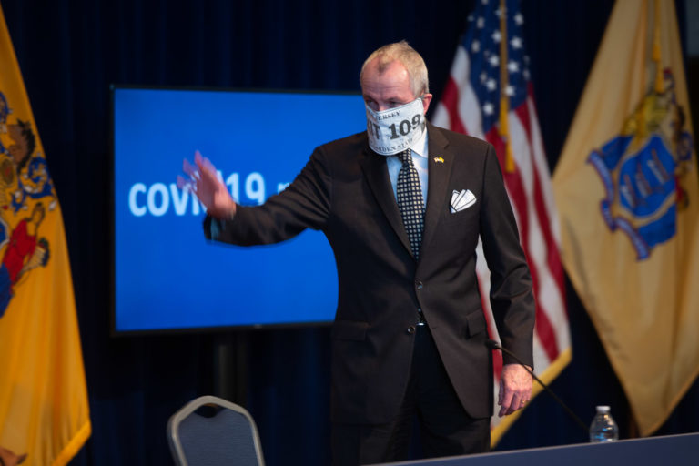 New Jersey Governor Phil Murphy wearing a mask that says 'EXIT 109' for his daily coronavirus briefing on Wednesday, April 8, 2020. (Pool photo by Michael Mancuso | NJ Advance Media for NJ.com)