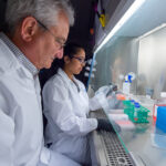 Dr. David Weiner and Dr. Ami Patel work on synthetic DNA technology.