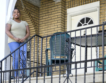 Evelyn Coates stands on the porch of her home in West Oak Lane on Tuesday, April 14, 2020. (Bastiaan Slabbers for WHYY)