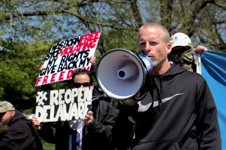 Rally organizer Jim McGuckin urges the Delaware government to allow businesses to reopen