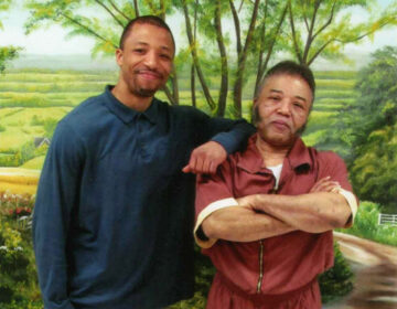 Rudolph Sutton poses with his son Rudolpho in a photo taken in 2015 at SCI-Graterford in Montgomery County, where Sutton was serving a life sentence. (Courtesy of Rudolpho Sutton)