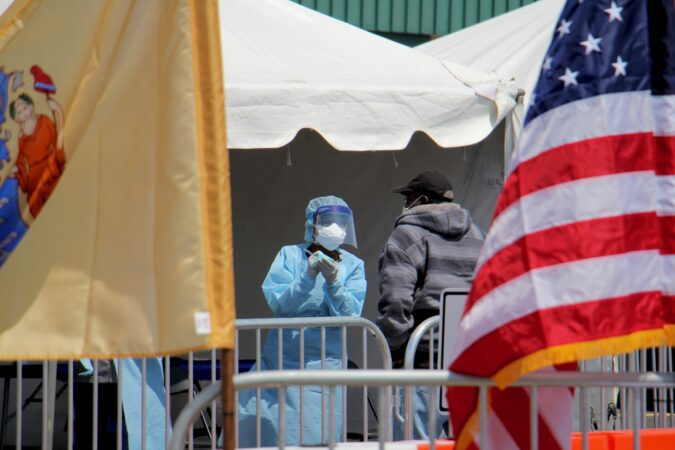 A candidate for COVID-19 testing is interviewed at a walk-up testing site at 2600 Mt. Ephraim Ave. in Camden, New Jersey. (Emma Lee/WHYY)