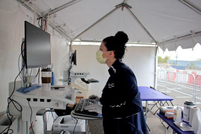 Medical technician Monica Campagna works at a COVID-19 testing site in the Motor Vehicle Commission parking lot in Camden New Jersey. (Emma Lee/WHYY)