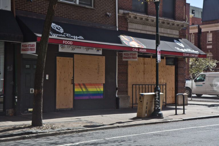 A pizza shop on 12th Street in Center City Philadelphia are boarded up during non-essential business shutdown orders aimed to slow the spread of COVID-19. (Kimberly Paynter/WHYY)