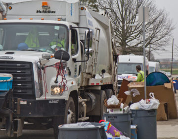 Sanitation workers in Northeast Philadelphia Monday. (Kimberly Paynter/WHYY)