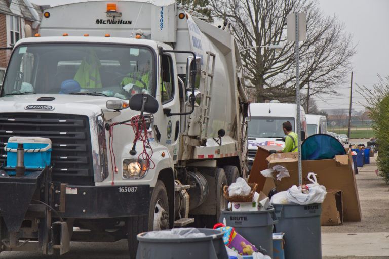 Sanitation workers in Northeast Philadelphia on March 30, 2020. (Kimberly Paynter/WHYY)