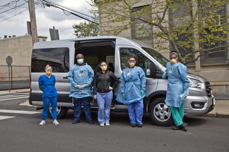 Dana Heller, 3rd medical student, Dr. Pierre Chanson, Natalie Gonzalez, 4th year medical student, Dr. Renell Dupree, and Dr. Ala Stanford, are part of the Black Doctors COVID-19 consortium. They are taking mobile testing at-risk zip codes in Philadelphia. (Kimberly Paynter/WHYY)