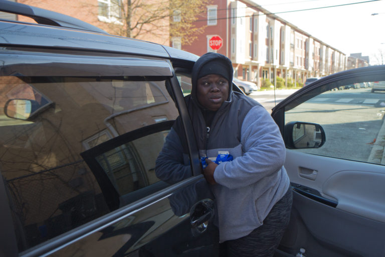 Sam Samuel delivers school lunches out of her van to families in West Philly's Mantua neighborhood. (Kimberly Paynter/WHYY)
