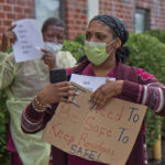 Julia Moore, a CNA  at the Care Pavilion Nursing and Rehabilitation Center in Walnut Park protested to demand better personal protective gear during the coronavirus crisis. (Kimberly Paynter/WHYY)