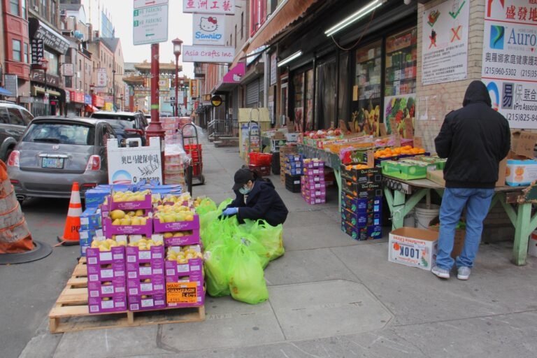 A produce market at 10th and Cherry streets is one of the few businesses still open in Chinatown. (Emma Lee/WHYY)