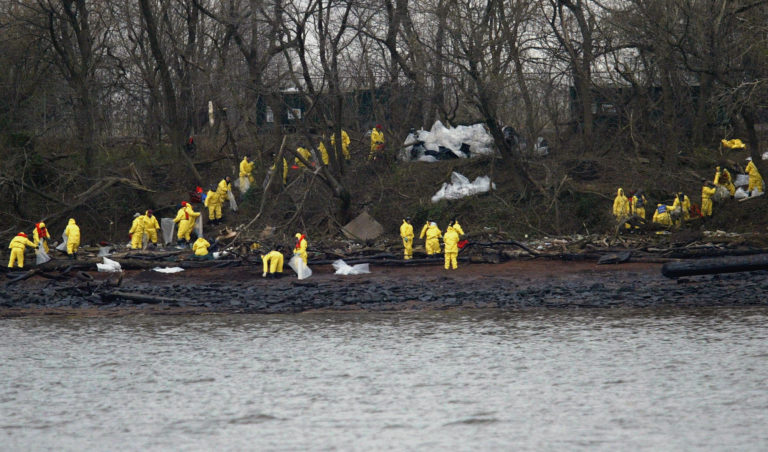 Work crews clean oil off the banks of the Delaware River in National Park, N.J., Monday, Dec. 6, 2004. The Athos I spilled as much as 470,000 gallons of thick crude oil into the Delaware River, killing wildlife and spreading along 70 miles of the waterway. (Joseph Kaczmarek/AP Photo)