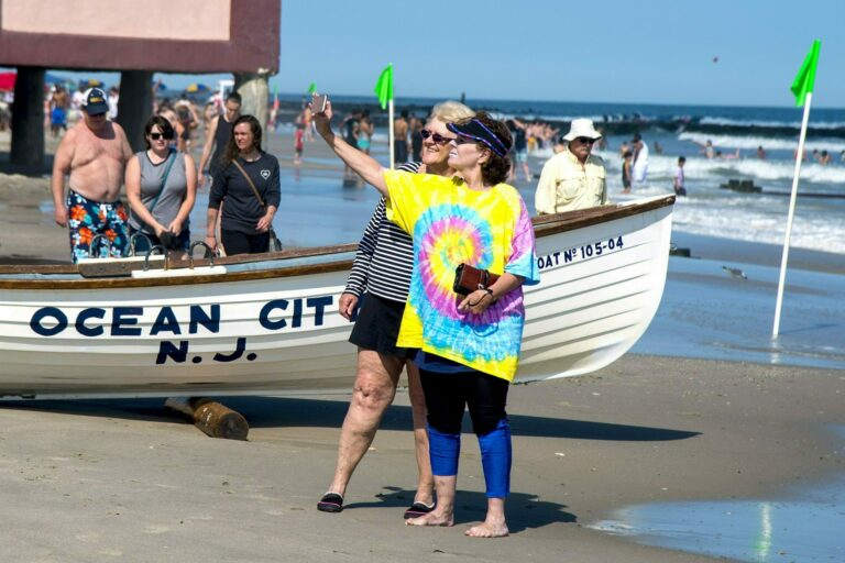 Jeanne Landgraf (left) of Mayfair, in Philadelphia, and Liz Thomsen (right) from Bailey, Colorado, shoot a selfie on the beach in Ocean City on May 27, 2019. (Tom Gralish/The Philadelphia Inquirer via AP)