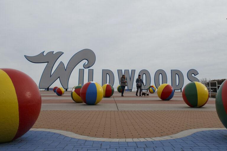 In this Jan. 23, 2020 photo, people walk a dog along the boardwalk in Wildwood, N.J. (Matt Slocum/AP Photo)