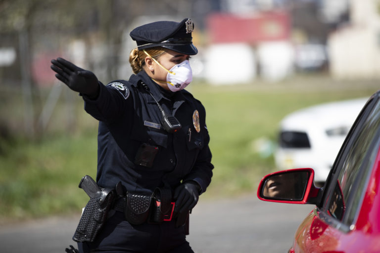 Camden County Police Officer Rodriguez wears a protective mask as she directs people to a COVID-19 testing facility in Camden, N.J., Wednesday, April 1, 2020. .(Matt Rourke/AP Photo)
