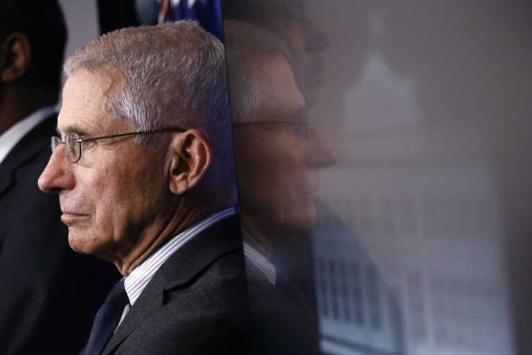 In this March 21, 2020 file photo, Director of the National Institute of Allergy and Infectious Diseases Dr. Anthony Fauci listens as President Donald Trump speaks during a coronavirus task force briefing at the White House in Washington. (AP Photo/Patrick Semansky)