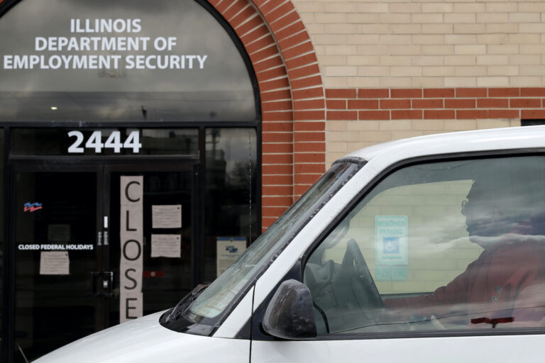 A man looks at the closed sign in front of Illinois Department of Employment Security in Chicago, Wednesday, April 15, 2020. More than 500,000 Illinois residents filed unemployment claims in just a five-week span during COVID-19 pandemic.  (AP Photo/Nam Y. Huh)