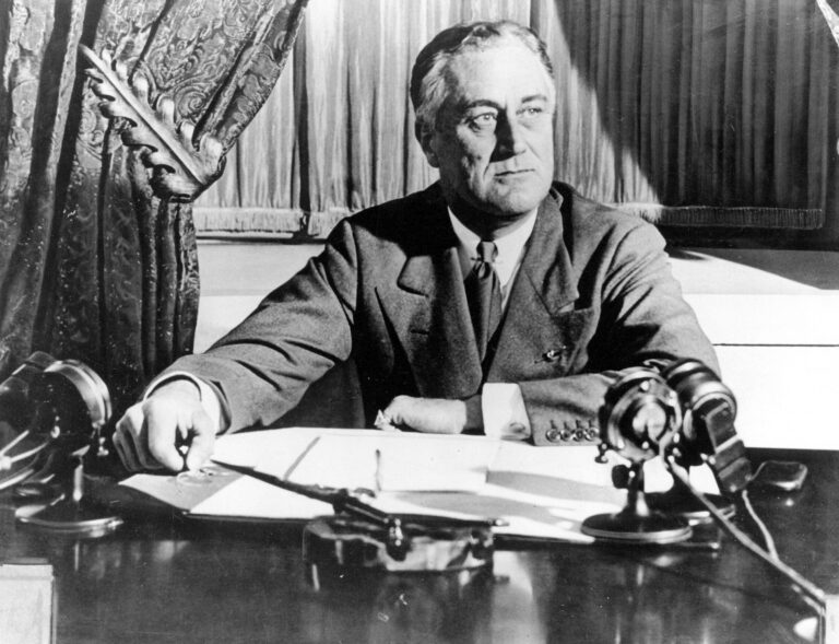 In this March 1933, file photo, President Franklin D. Roosevelt delivers his first radio