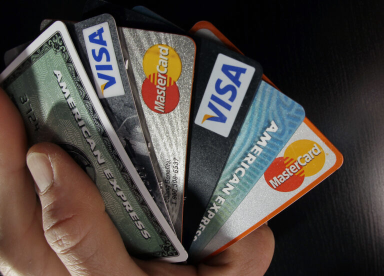 In this March 5, 2012 file photo, consumer credit cards are posed in North Andover, Mass. (Elise Amendola/AP Photo)
