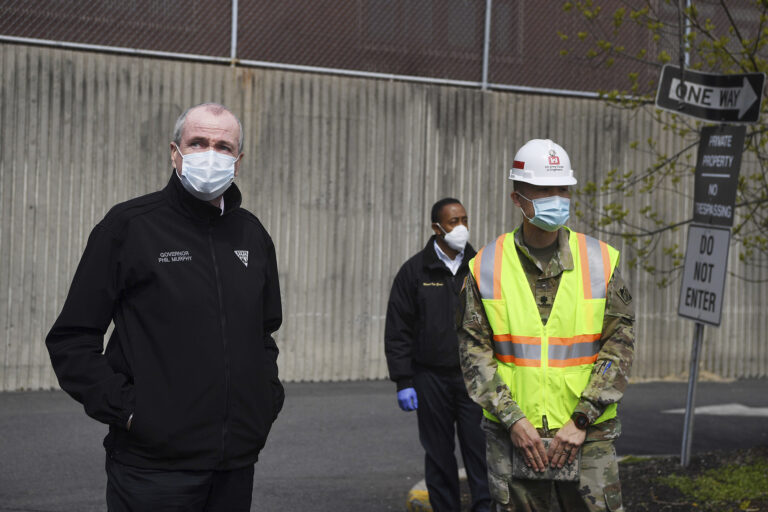 New Jersey Gov. Phil Murphy, left, visits an alternate care facility at East Orange Hospital in East Orange, N.J., amid the coronavirus pandemic, on Wednesday, April 22, 2020. (Michael Karas/The Record via AP, Pool)