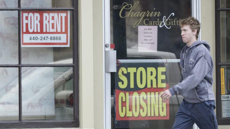 Man walks past closed business amid coronavirus pandemic.