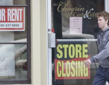 Man walks past closed business