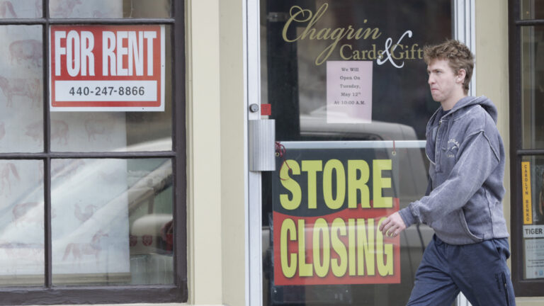 Man walks past closed business