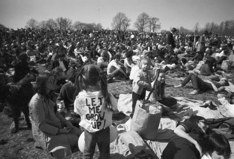 In this April 23, 1970, file photo, part of crowd observing Earth Day, including, youngster wearing