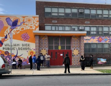 People outside William Dick Elementary School in North Philadelphia waited to pick up Chromebooks on April 7. (The Notebook)