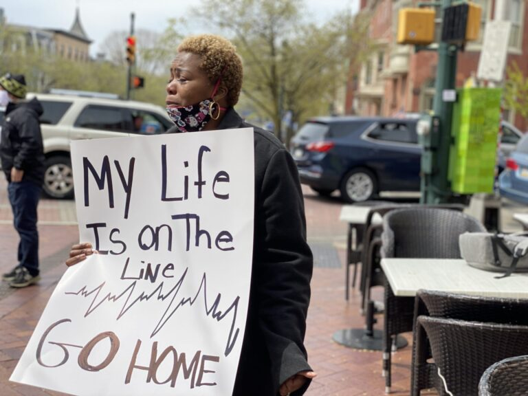 Yetta Timothy, a certified nursing assistant in Harrisburg, was among a small group of health care workers who showed up to counter-protest the larger April 20, 2020, rally urging the quick reopening of Pennsylvania's economy. (Joseph Jaafari/PA Post)
