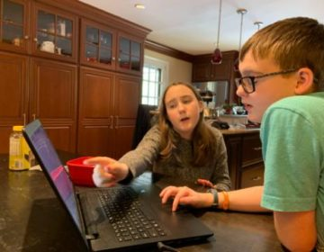 In the Kauffman household in Radnor, sister Shelby helps out brother Jake with his school work. (Courtesy of Carrie Kauffman)