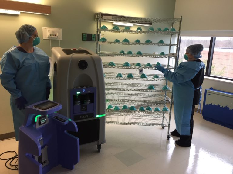 Doylestown Health workers place used N95 masks on a rack for HPV sanitation. (Courtesy of Ron Watson/Doylestown Health)