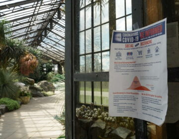 Signs are posted throughout the conservatories and in all buildings at Longwood Gardens where essential staff are working during the coronavirus shutdown. (Courtesy of Longwood Gardens/Carol Gross)