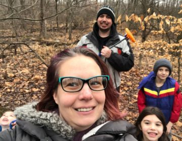 Dawn Sites with her family in the woods behind her house. Her son Jaiden wears a blue, red and yellow jacket. (Courtesy of Dawn Sites)