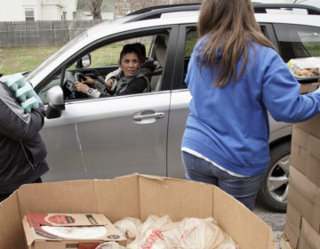 Together Inc. food bank workers distribute food at a drive-through location in Omaha, Neb., last week. Disruptions in the agricultural supply chain caused by the coronavirus pandemic are making it difficult for food banks. (Nati Harnik/AP Photo)