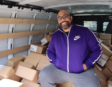 Deavin Reaves, executive director of the PA Harm Reduction Coalition, in front of a shipment of Narcan COURTESY DEVIN REAVES