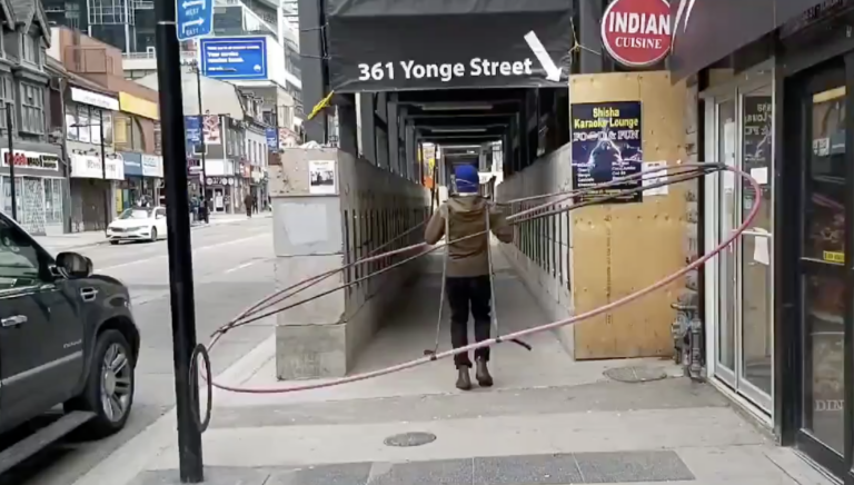 A Toronto geographer is using a large ring to study and demonstrate how difficult it is to keep a social distance of six feet in the urban environment. (Daniel Rotsztain)