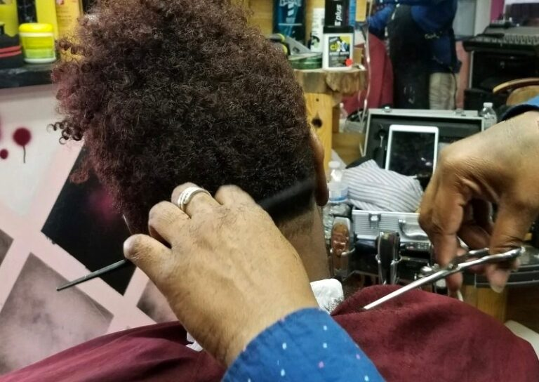 The Pennsylvania government doesn't consider barbershop essential businesses. But some people who work in them, and who visit, disagree. (Andrea Gibbs/WHYY)