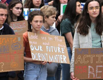 Philadelphia students cut class Friday, May 3, 2019 to participate in a rally at Thomas Paine Plaza to protest inaction on climate change issues. (Emma Lee / WHYY)